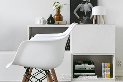 Светлая мебель и чёрнобелые фото в скандинавском дизайне